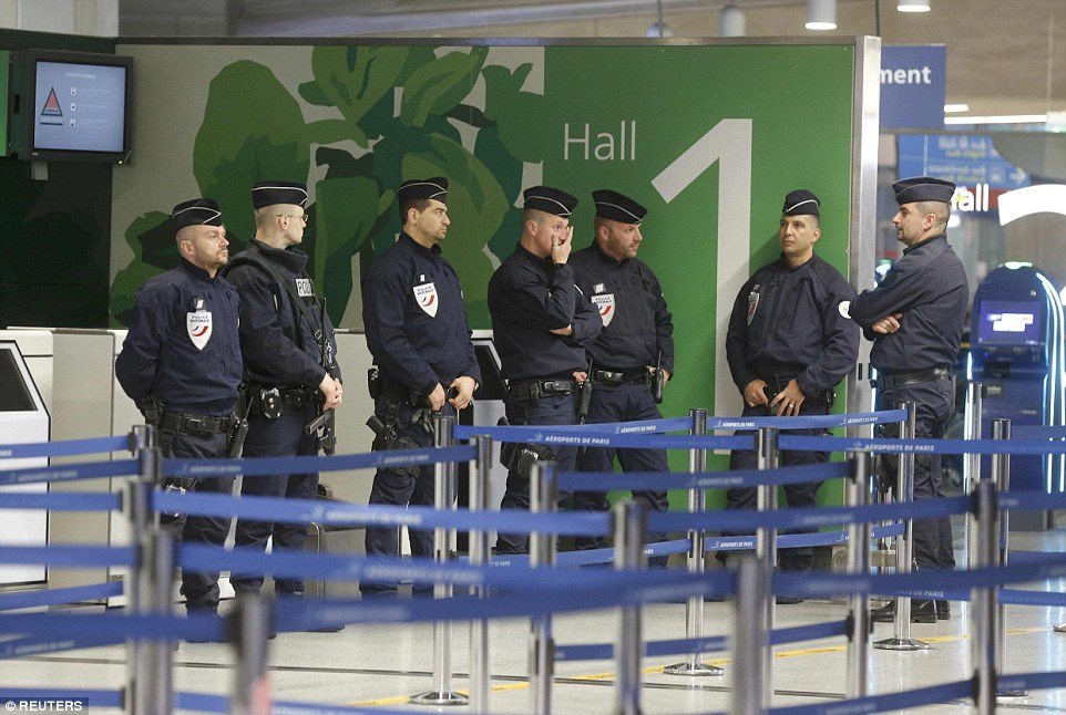 Police take up position at Terminal 1 at Charles de Gaulle airport, after the EgyptAir flight vanished from radar