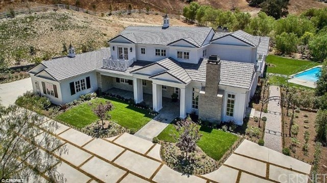Bigger is better:The new 7,000 square foot home is white Cape Cod style with a big driveway