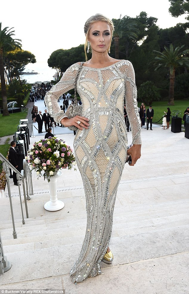 Sparkling: A dangly pair of earrings complemented her frock perfectly, while her delicate decolletage was on full display with the dress designed to fit her body's curves