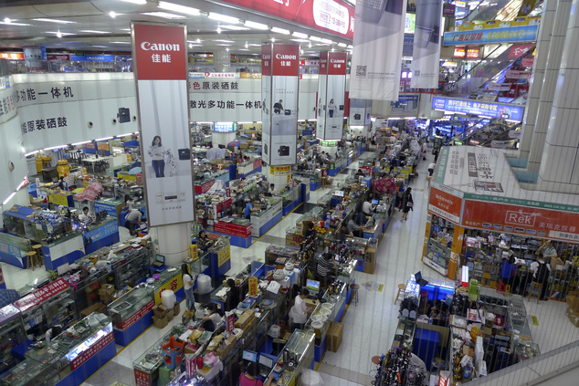 In this April 22, 2016 photo, buyers and vendors are seen at Shenzhen's Seg electronics market, a popular place for hardware startup entrepreneurs to buy com...