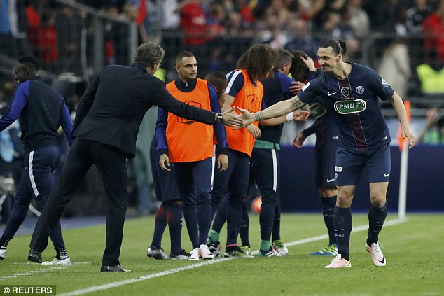The Swede touches hands with coach Laurent Blanc as he signs off his PSG career with another treble