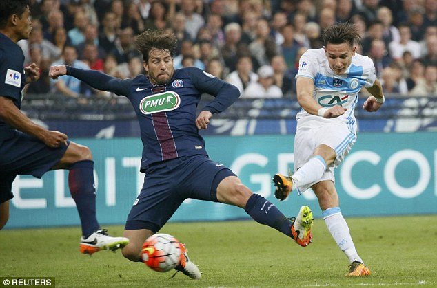 Marseille forward Thauvin gets his shot away under pressure from PSG defender Maxwell