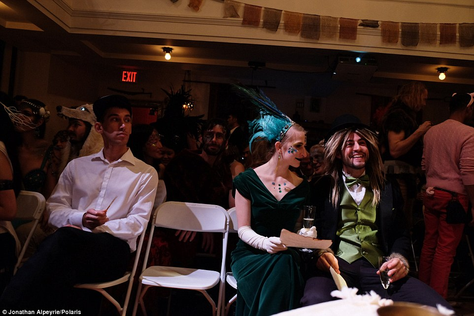 Guests wait for the wedding between Michel and Rasmus in December 2015 to start. They're dressed in array of costumes for the nuptials