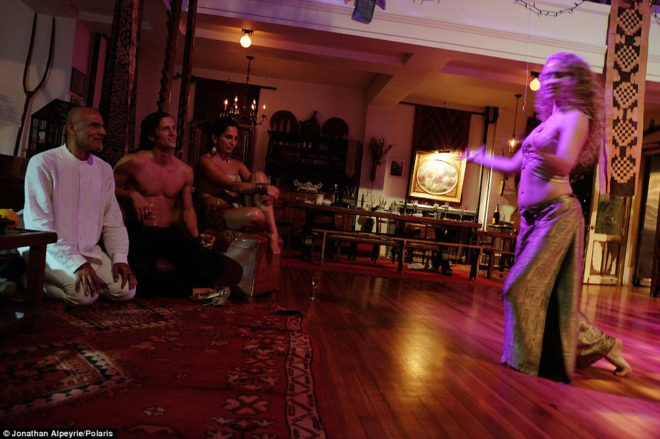 One of the lovers dances during a private dinner at the house. Since Madie moved into the house, he has had complaints from neighbors who say it is really an unlicensed nightclub