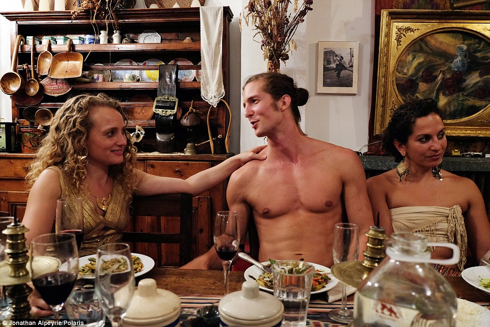 Michel's lover Rasmus, a Swedish man, is sitting between two Polyamorous ladies during a dinner at their Harlem, New York, home