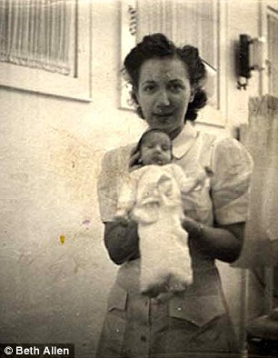One of Couney's nurses with a premature baby