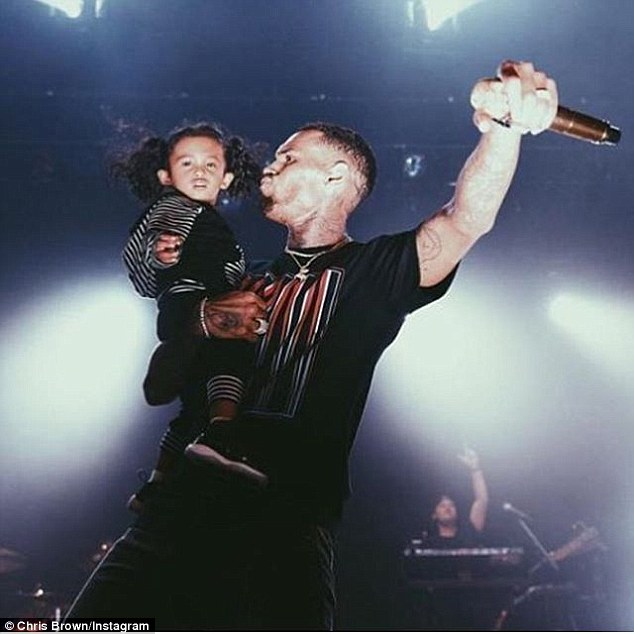 Doting dad: Singer Chris Brown has won a legal victory after a judge denied his daughter's mother's bid to reduce his custody of Royalty