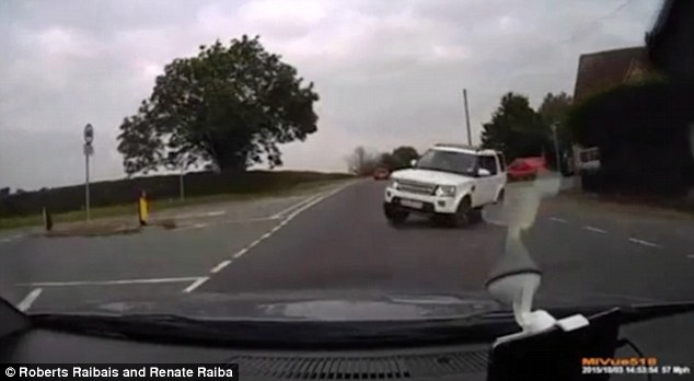 Reckless manoeuvre: Nay's white Land Rover Discovery 3 is seen pulling out in front of oncoming traffic