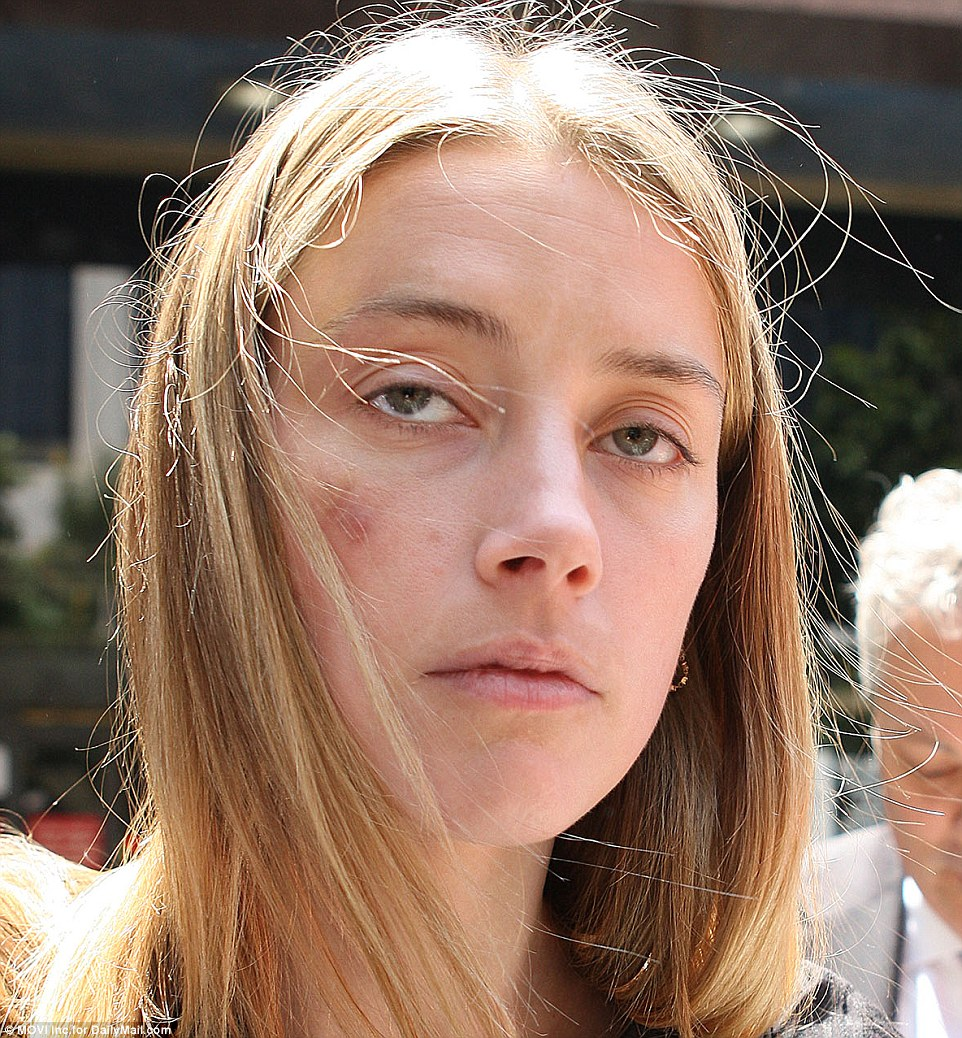 Amber Heard, 30, was granted a temporary restraining order against her estranged husband Johnny Depp in a California court (above on Friday)