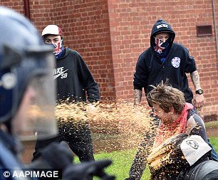 One protester was brought down to his knees as the spray hit him directly in the face