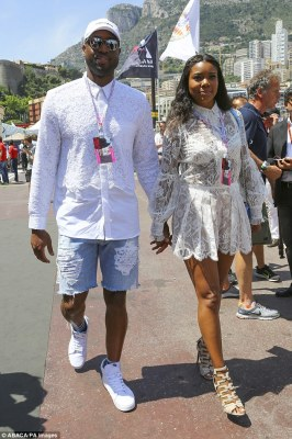 Sheer ambition: Gabrielle Union showed off her white lingerie by wearing a see-through dress while with Dwayne Wade at the Grand Prix on Saturday