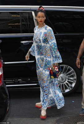 Traffic stopper: The Diamonds singer no doubt stopped a few cars when she emerged from her own large chauffeured SUV