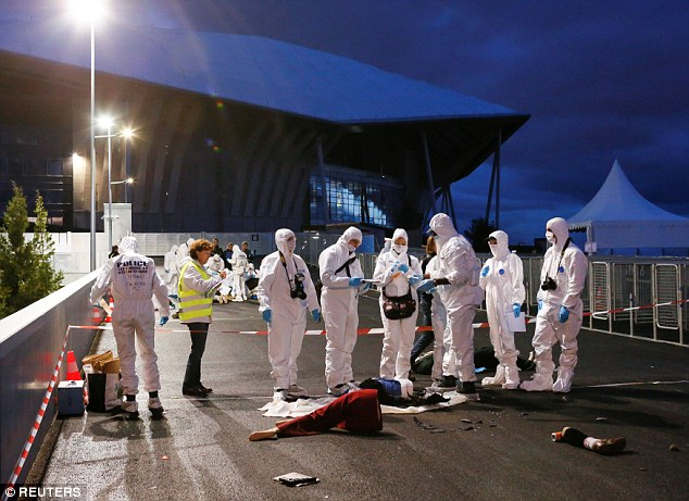 French forensic officers take part in a mock terror attack drill outside the Stade des Lumieres, near Lyon today. The drill saw the officers looking over a fake crime scene that included dismembered bodies
