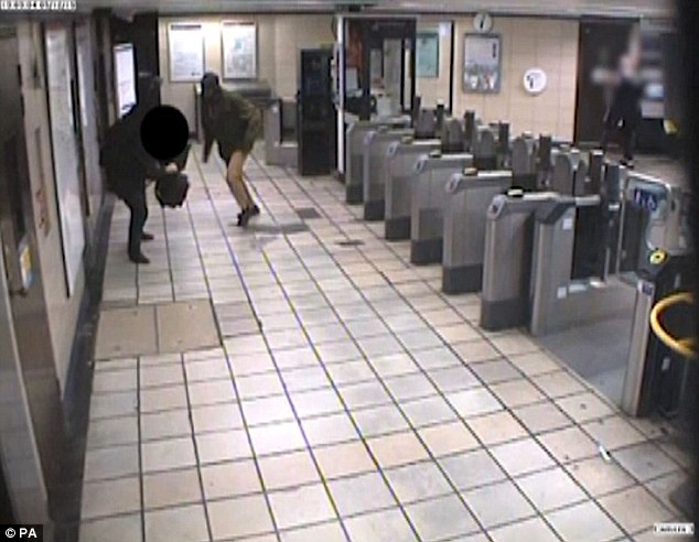 Mire is seen approaching Mr Zimmerman at Leytonstone station. The footage, from CCTV, was shown to the jury at the Old Bailey today