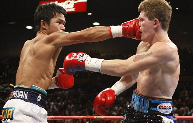 Champ: Ricky's only two career losses were against Floyd Mayweather and Manny Pacquiao (pictured  during their Las Vegas bout in 2009)