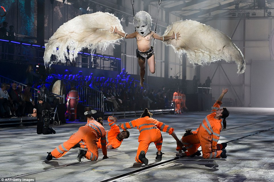 Flying baby: The Swiss have put on one of the most bizarre opening ceremonies in history to mark the completion of the world's longest tunnel