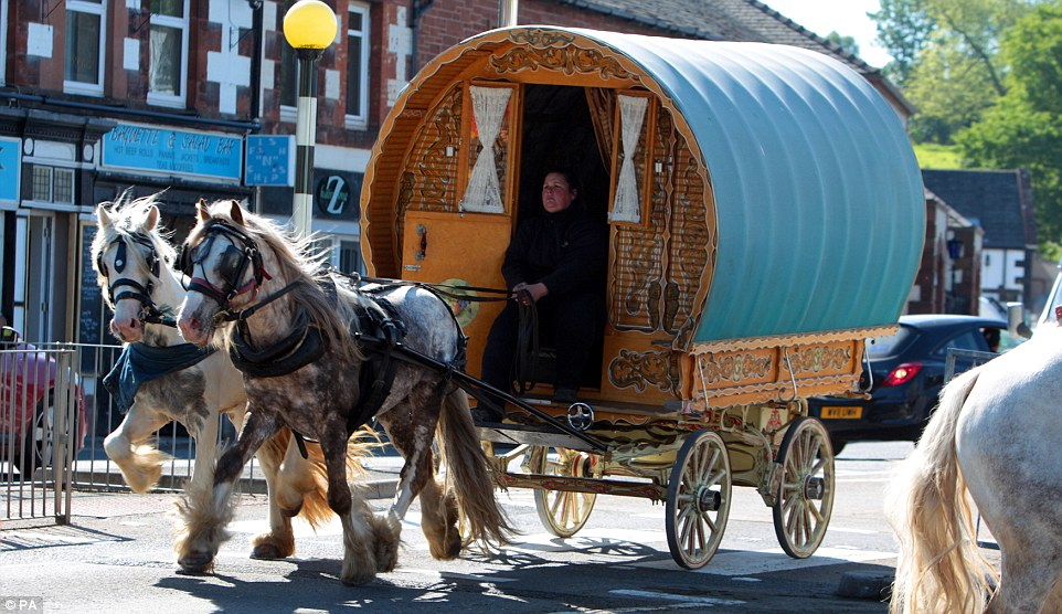 Old School: While pleasing to the eye, this traditional carriage must be particularly tricky to manoeuvre on the busy roads of Appleby