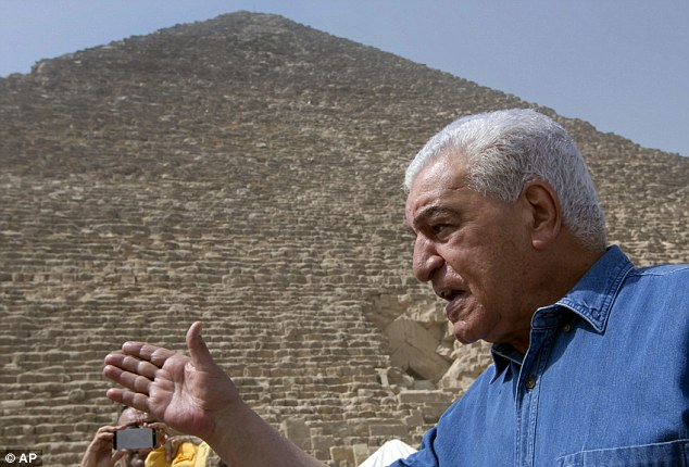 Dr Zahi Hawass (pictured outside the Great Pyramid), a leading Egyptian archaeologist and Egypt's former head of antiquities has been working with a team of French researchers who have been conducting the scans