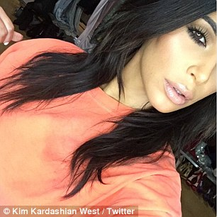 Glamorous for gun safety! Kim Kardashian also wore orange in a sultry selfie to show her support for gun safety