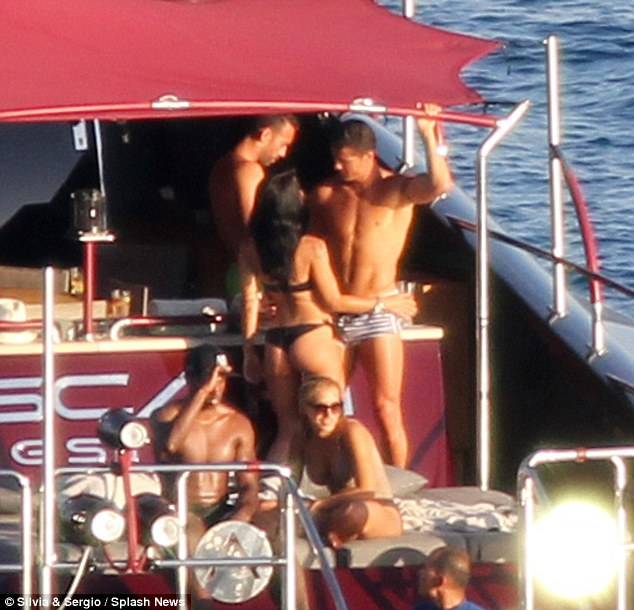 Cosy:Seemingly helping him to de-stress and unwind ahead of EUFA 2016 Cristiano Ronaldo enjoyed the company of a curvaceous brunette, who danced with him aboard a luxury yacht in Ibiza on Friday