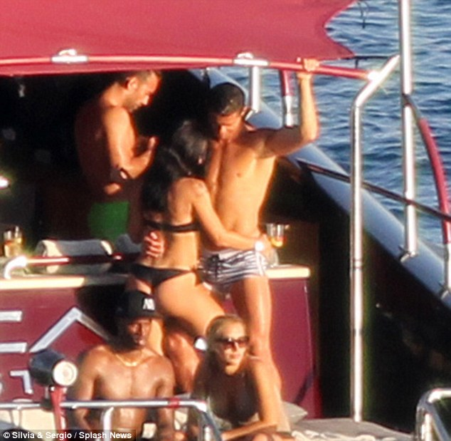 Tanned and toned: Clad in a pair of minuscule striped swimming trunks, the Portuguese athlete showed off every inch of his gym-honed body, flaunting his muscular physique