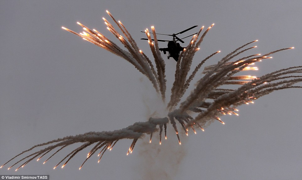 The pilot of a Kamov Ka 50 helicopter showed off their precision and accuracy as they flew between a flurry of flares