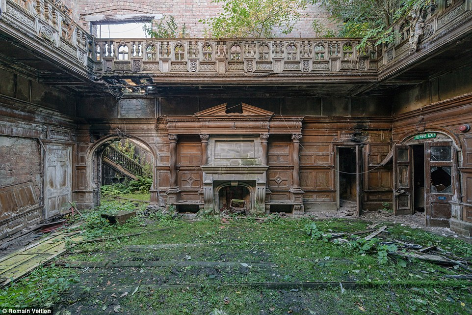Once a stately manor, this abandoned property in Scotland - with a fireplace and wood-panelled walls - has been reclaimed by nature