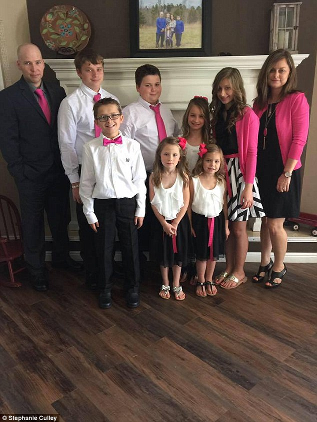 At Laitkep's funeral, the entire family (pictured) showed up in pink and the girls wore matching bows in their hair