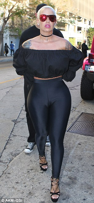 The 32-year-old put her incredible figure on display in a crop top and skintight leggings while running errands