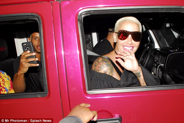 Good to see you! The star gave her fans a wave and a smile as she left in her pink ride