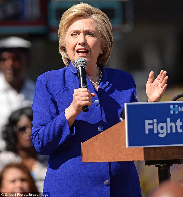 Center stage: Hillary pictured at the South Los Angeles Get Out The Vote event at Leimert Park Village Plaza in Los Angeles