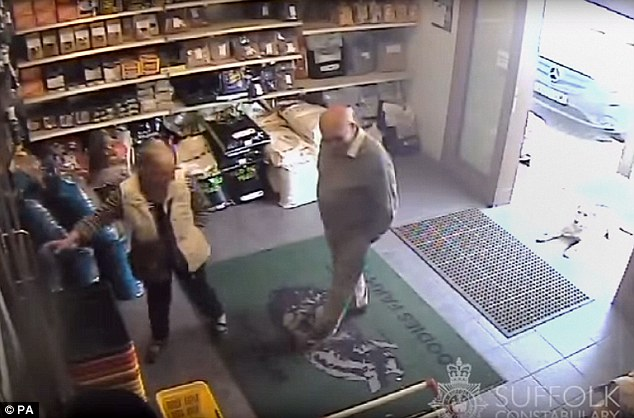 Seen on CCTV: Happily browsing in a farm shop, these are the last known movements of a murdered line dancing enthusiast and his missing wife - as police reveal the prime suspect in the case has fled abroad