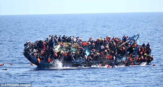 Five African states - Nigeria, Senegal, Mali, Niger and Ethiopia - will be targeted to curtail migration and incentives may include preferential trade terms and easier visa access to the EU. Pictured: A sinking migrants' boat near Libya