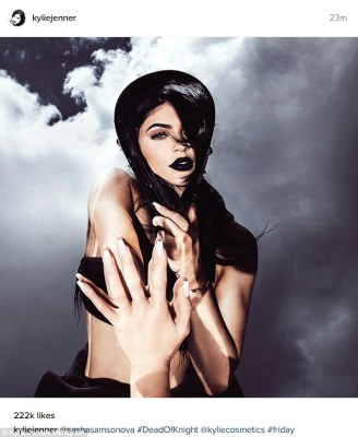 Moody:The reality diva also shared a photo where she was in a black swimsuit top and a skirt with her raven locks flying in the air. A pile of clouds were behind her and she was reaching a hand out