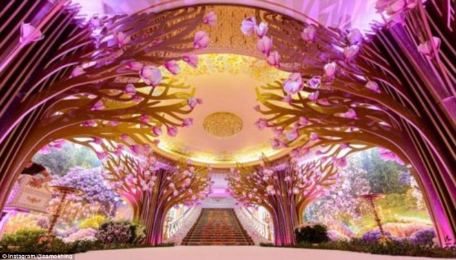 Inside or out? The entrance to the reception at Safisa, where the bride changed her dress twice more, was a spectacular forest (above)