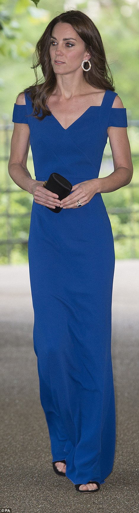 The Duchess showcased her slim figure in a dazzling cut-out shoulder dress in royal blue.