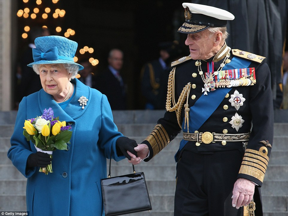 Lasting love: The Queen takes Prince Philip's hand as the royal couple leave a service of commemoration for fallen British troops