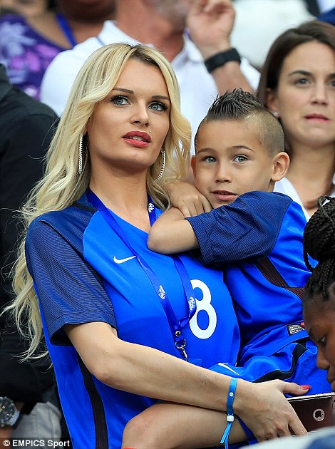 France's midfielder Dumitri Payet's wife Ludivine Payet is pictured with their son at the match tonight