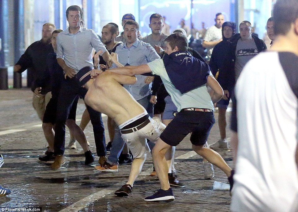 English supporters clash with French locals during the troubling violence that erupted onto the streets of Marseille's Old Port