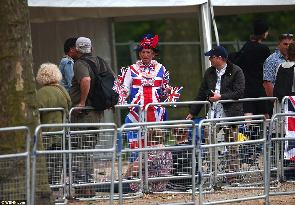 Getting into the spirit: Some of the monarch's more passionate fans were easy to spot, such as this man dressed head-to-toe in Union Jack-themed clothes and waving flags
