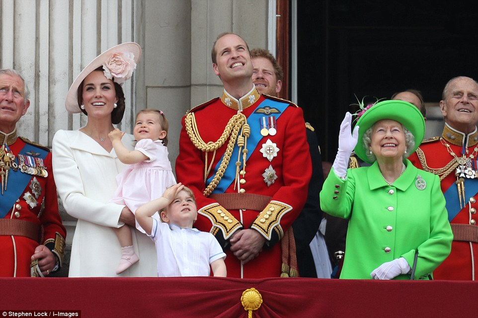 Up in the air: Prince George, centre, appeared to give the planes a salute while his 'gan-gan', second right, waved at the pilots soaring overhead. Also pictured (from left): Prince Charles, the Duchess of Cambridge, Princess Charlotte, Prince William, Prince Harry and Prince Philip