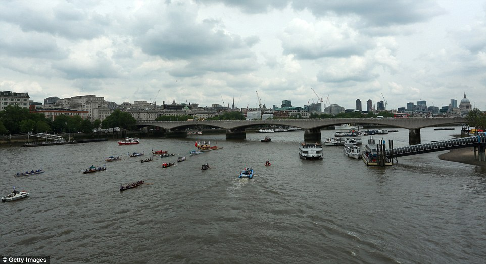 River tribute: Royal barge Gloriana led a 40-strong flotilla down the Thames to mark the Queen's official birthday today