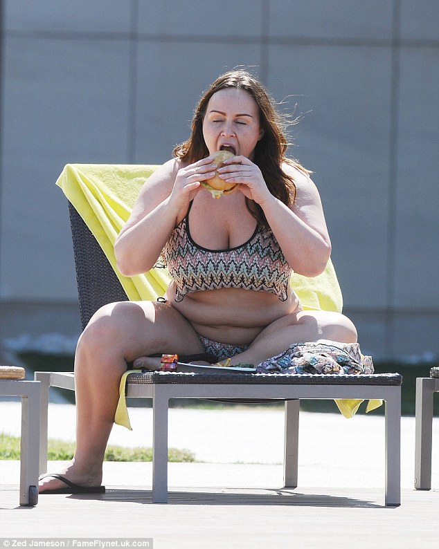 Tasty! Chanelle Hayes, 28, certainly looked to be enjoying her burger as she tucked into the savoury snack poolside while holidaying in Alicante, Spain, on Wednesday