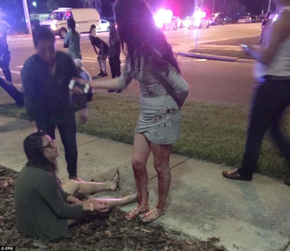 Attack: A Woman Sits On The Ground Outside The Club While Another Party Goer