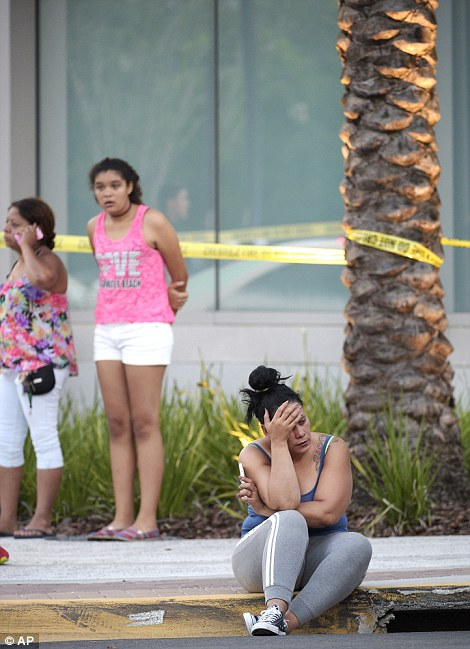 People wait outside the emergency entrance of the Orlando Regional Medical Center hospital after the shooting at Pulse gay club