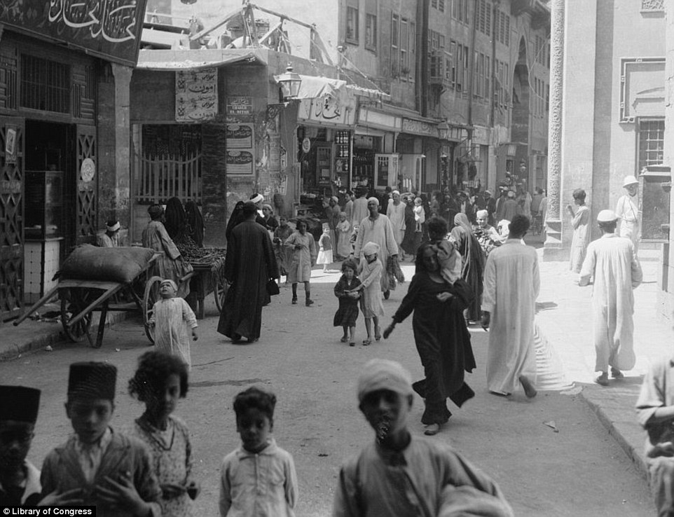 A bustling street in Old Cairo, pictured in 1934, showing children playing by themselves while the adults went about their business