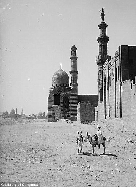 A man waits outside Sultan el-Ashraf's tomb and mosque, pictured in 1900