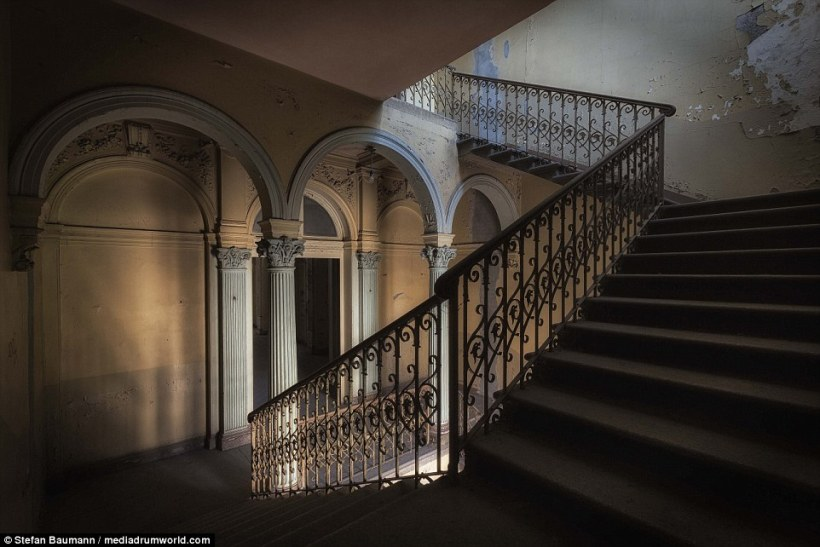 This beautiful staircase is part of an abandoned villa in Germany that was last used as a home for elderly people