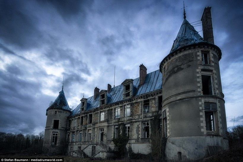 Like something out of a gothic ghost story, this abandoned chateau in France strikes a gloomy scene with glassless windows and battered shutters surrounded by wintry trees