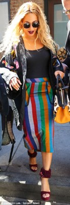 Bold: The 34-year-old was spotted leaving her Big Apple hotel in a patterned kimono, multi-colored striped pencil skirt and a black skintight top
